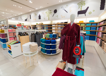centres: BANGKOK - MARCH 17, 2016: Various towels and bathrobes at a store of home goods in the Siam Paragon Mall. It is one of the biggest shopping centres in Asia. Editorial