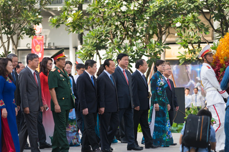 authorities: HO CHI MINH CITY, VIETNAM - MAY 19, 2016: The city authorities bring flowers to the Ho Chi Minhs monument on his birthday, an official public holiday.