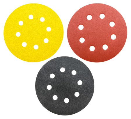 perforated: three perforated abrasive wheel, isolated over white