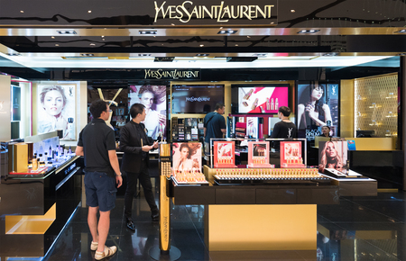 priced: BANGKOK - MARCH 17, 2016: Yves Saint Laurent store in the Siam Paragon Mall. YSL is a luxury fashion house founded in 1961 by Yves Saint Laurent and his partner, Pierre Berge.