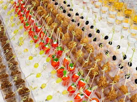 a lot of cold snacks and drinks on buffet table, catering Stock Photo