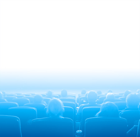viewers: viewers watch motion picture at movie theatre, blue toning white space Stock Photo