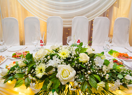 laid: laid wedding banquet table with flowers at restaurant