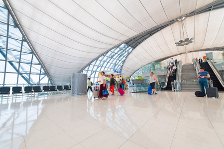 walk board: BANGKOK - MARCH 18, 2016: Unidentified air passengers walk to board at the departure area of the International Airport Suvarnabhumi which is the sixth busiest airport in Asia. Editorial