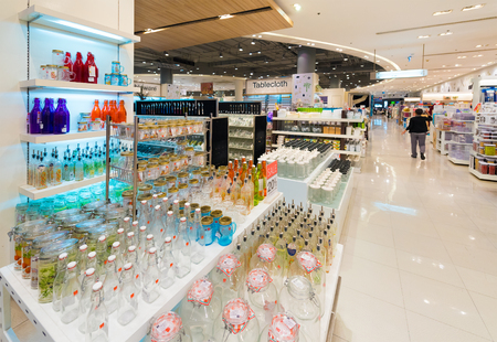 paragon: BANGKOK - MARCH 17, 2016: Various empty glass jars and bottles at a store in the Siam Paragon Mall. It is one of the biggest shopping centres in Asia. Editorial