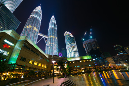 city centre: KUALA LUMPUR - JUNE 14, 2016: A night view at skyscrapers including Petronas Towers in the city center. Kuala Lumpur is the national capital and most populous global city in Malaysia.