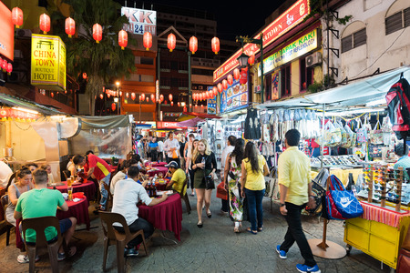 street night: KUALA LUMPUR - JUNE 15, 2016: A lot of people walk in Chinatown in the evening, commonly known as Petaling Street. There are lots of budget hotels and cheap food in this neighborhood. Editorial