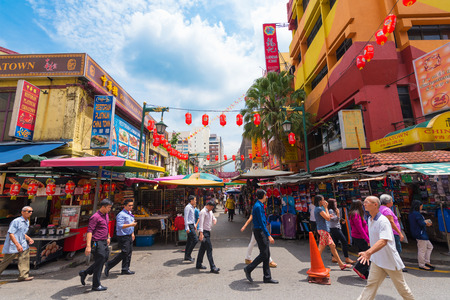 street market: KUALA LUMPUR - JUNE 15, 2016: A lot of people walk in Chinatown, commonly known as Petaling Street. There are lots of budget hotels and cheap food in this neighborhood. Editorial