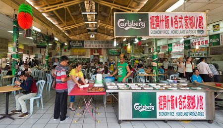 dine: KUALA LUMPUR - JUNE 15, 2016: People buy food and dine at the China Town Food Court. There are lots of budget hotels and cheap food in this neighborhood.