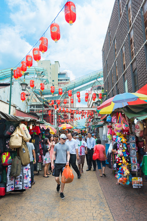 center city: KUALA LUMPUR - JUNE 15, 2016: A lot of people walk in Chinatown, commonly known as Petaling Street. There are lots of budget hotels and cheap food in this neighborhood. Editorial