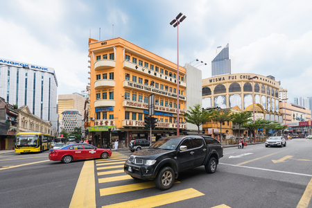 tun: KUALA LUMPUR - JUNE 15, 2016: Vehicles move along Jalan Tun Tan Cheng Lock Street in the city center. Most city colonial buildings were built in the end of the 19th and early 20th centuries.