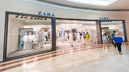 retailer: KUALA LUMPUR - JUNE 15, 2016: The Zara store in the Suria KLCC mall. Zara is a Spanish clothing and accessories retailer, the main brand of the Inditex group, the worlds largest apparel retailer. Editorial