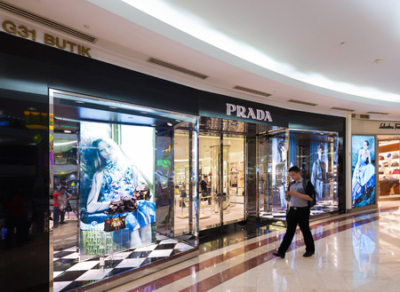prada: KUALA LUMPUR - JUNE 15, 2016: Prada store in Suria KLCC mall. Prada S.p.A. is an Italian luxury fashion house, specializing in leather handbags, travel accessories and other fashion accessories. Editorial