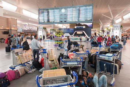 baggage: KUALA LUMPUR - JUNE 16, 2016: A lot of unidentified air passengers stand and walk in the departure area of the Kuala Lumpur Airport 2. KLIA 2 is the low cost carrier terminal at KLIA. Editorial