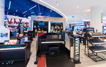 centres: BANGKOK - MARCH 17, 2016: A view at a store of musical instruments in the Siam Paragon Shopping mall. It is one of the biggest shopping centres in Asia.