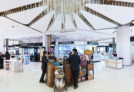 priced: BANGKOK - MARCH 17, 2016: A view at various cosmetics stores of luxury brands in Siam Paragon shopping mall. It is one of the biggest shopping centers in Asia.