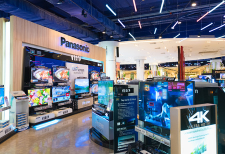 paragon: BANGKOK - MARCH 17, 2016: Viera plasma displays at Panasonic store in the Siam Paragon mall. It was built in 1973 and was one of Bangkoks first shopping malls.