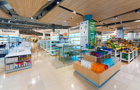 centres: BANGKOK - MARCH 17, 2016: A wide range of glassware at the Living store in the Siam Paragon Mall. It is one of the biggest shopping centres in Asia.