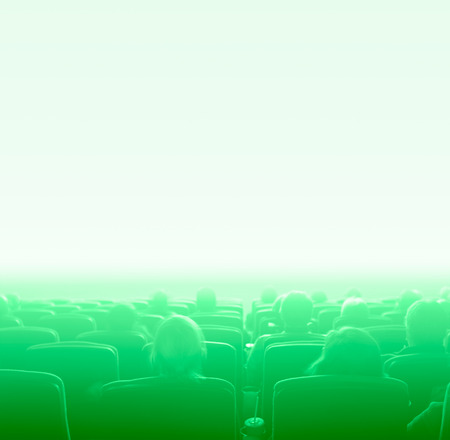 viewers: viewers watch motion picture at movie theatre, green toning space