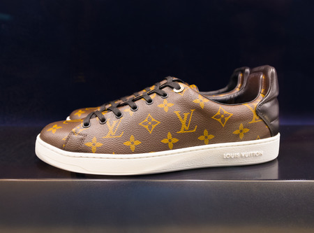 KUALA LUMPUR - JUNE 15, 2016: Louis Vuitton trainers in a showcase at the Suria KLCC shopping mall. For years 2006–2012 LV was named the worlds most valuable luxury brand.