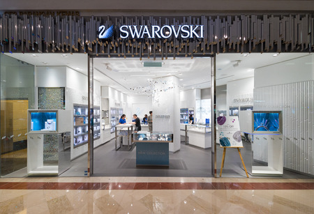 swarovski: KUALA LUMPUR - JUNE 15, 2016: Unidentified people shop at Swarovski store in Suria KLCC mall. The mall is located in the Kuala Lumpur City Centre district near the famous Petronas Towers.