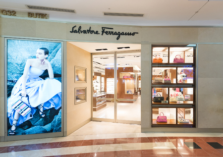boutique: KUALA LUMPUR - JUNE 15, 2016: Salvatore Ferragamo store in the Suria KLCC mall. Salvatore Ferragamo is an Italian luxury goods company specializing in shoes, leather goods, and ready to wear.