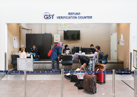 airport check in counter: KUALA LUMPUR - JUNE 16, 2016: Customs officers inspect items before validation of GST Refund in KLIA 2 airport. Approximately 52,000 people benefit each day from tax free shopping around the world.