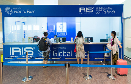 KUALA LUMPUR - JUNE 16, 2016: People get GST refund at the Iris Global Blue counter in KLIA 2 airport. Approximately 52,000 people benefit each day from tax free shopping around the world. Editorial