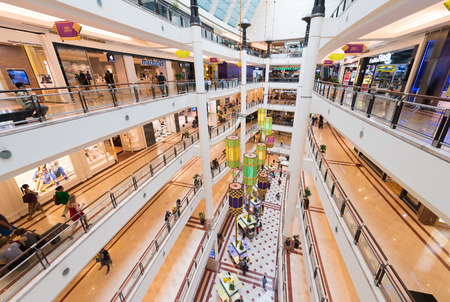 KUALA LUMPUR - JUNE 15, 2016: A wide angle view inside Suria KLCC shopping mall. The mall is located in the Kuala Lumpur City Centre district near the famous Petronas Towers.