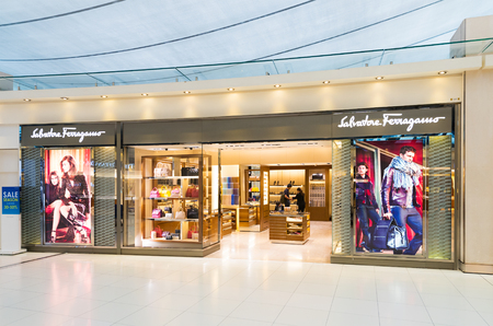 luxury goods: BANGKOK - DEC 17, 2015: Salvatore Ferragamo store in Suvarnabhumi International Airport. Salvatore Ferragamo is an Italian luxury goods company specializing in shoes, leather goods, and ready to wear. Editorial