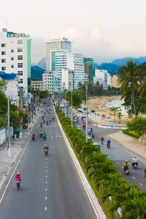 tran: NHA TRANG, VIETNAM - JANUARY 1, 2016: Unidentified vehicles drive on Tran Phu Street along the sea shore, full of a lot of hotels. Nha Trang is a popular sea resort in southern Vietnam.