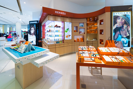 high priced: BANGKOK - MARCH 17, 2016: A view at various cosmetics stores of luxury brands in Siam Paragon shopping mall. It is one of the biggest shopping centers in Asia.