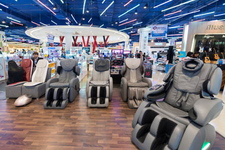 BANGKOK - MARCH 17, 2016: Vibrating massage armchairs for sale in the Siam Paragon Mall. It is one of the biggest shopping centers in Asia.
