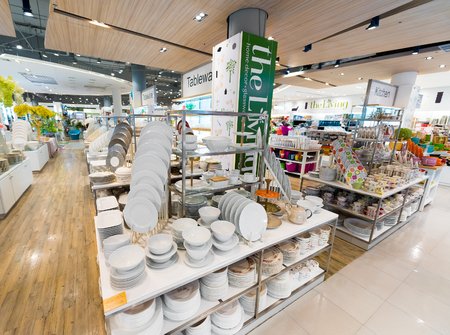 centres: BANGKOK - MARCH 17, 2016: A wide range of tableware at the Living store in the Siam Paragon Mall. It is one of the biggest shopping centres in Asia. Editorial