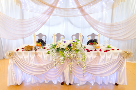 laid: laid white wedding banquet table at restaurant