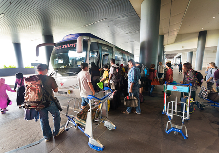 bus station: KUALA LUMPUR - JUNE 14, 2016: People get on a bus to the city center at the Kuala Lumpur International Airport 2. KLIA 2 is the low cost carrier terminal at KLIA.