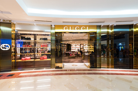 gucci store: KUALA LUMPUR - JUNE 15, 2016: The Gucci store in Suria KLCC mall. Gucci is an Italian luxury brand of fashion and leather goods, part of the Gucci Group owned by the French holding company Kering. Editorial