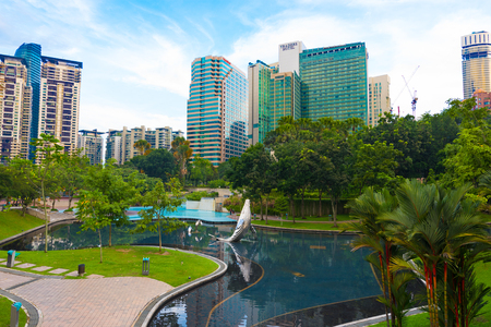KUALA LUMPUR - JUNE 15, 2016: A view at the KL City Centre Park located in front of Petronas Towers. Kuala Lumpur is the national capital and most populous global city in Malaysia.