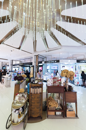 paragon: BANGKOK - MARCH 17, 2016: A view at various cosmetics stores of luxury brands in Siam Paragon shopping mall, one of the biggest shopping centers in Asia.