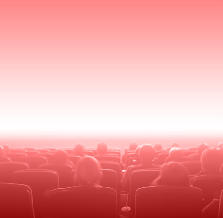 motion picture: viewers watch motion picture at movie theatre, red toning, copy space