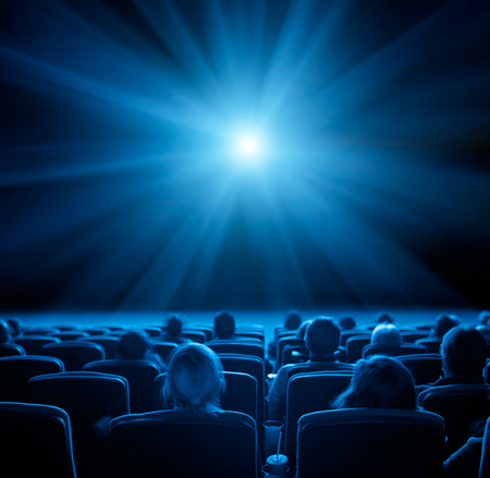 viewers: viewers watch film at movie theatre, long exposure, blue glow