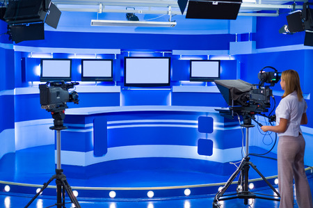 teleoperator works at television empty blue studio photo