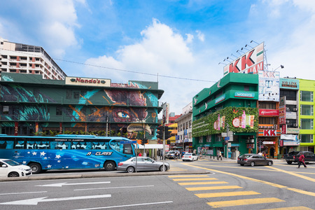 graffito: KUALA LUMPUR - JUNE 15, 2016: Vehicles move along Jalan Pudu Street in the city center. Most city colonial buildings were built in the end of the 19th and early 20th centuries.
