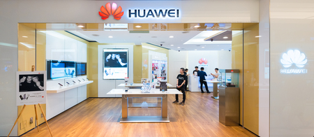 headquartered: KUALA LUMPUR - JUNE 15, 2016: The Huawei store in the Suria KLCC. Huawei Technologies, headquartered in China, is the largest telecommunications equipment manufacturer in the world.
