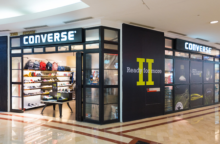 converse: KUALA LUMPUR - JUNE 15, 2016: A view of the Converse store in the Suria KLCC shopping mall. Converse is known as one of Americas most iconic footwear companies. Editorial