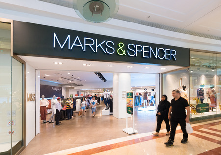 spencer: KUALA LUMPUR - JUNE 15, 2016: The Marks and Spencer store in the Suria KLCC mall. Marks and Spencer plc (also known as M&S) is a major British multinational retailer.