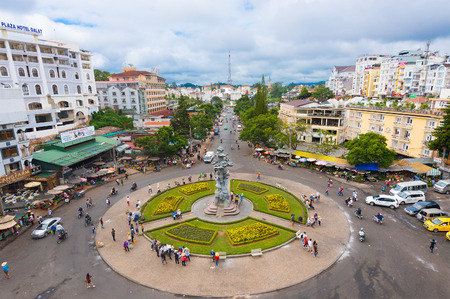 dalat: DA LAT, VIETNAM - AUGUST 6, 2016: A high angle view at the square in front of the Da Lat city market in the downtown. Dalat is famous with its red wine, grapes, coffee and roses.