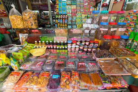 dalat: DA LAT, VIETNAM - AUGUST 6, 2016: A wide range of food at the Central City Market, Cho Dalat. Dalat is famous with its wine as well as with strawberry and candied fruit.