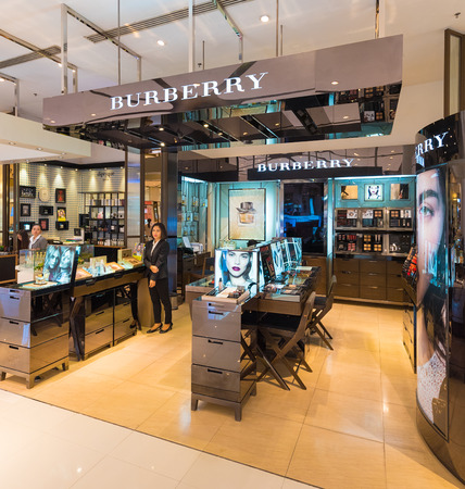 paragon: BANGKOK - MARCH 17, 2016: A view at a Burberry store the Siam Paragon Shopping mall. Burberry, a British luxury fashion house, has more than 500 stores in over 50 countries. Editorial