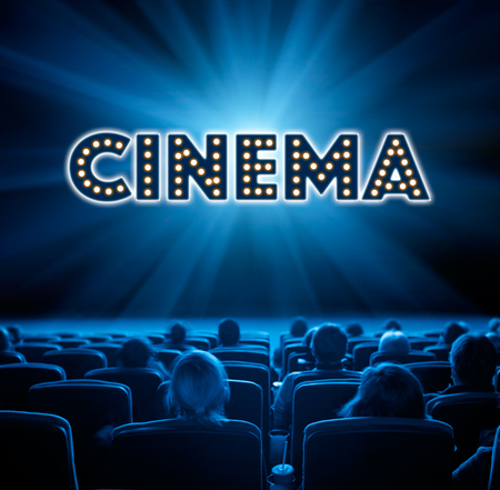 viewers: viewers watch film at cinema, long exposure, blue glow Stock Photo